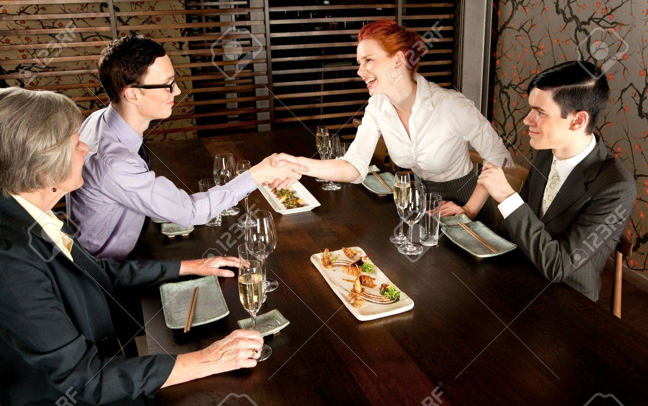 Four people people meeting for lunch Stock Photo - 10385554