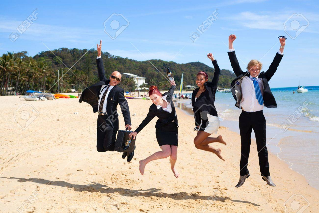4 business people jumping - 11423639