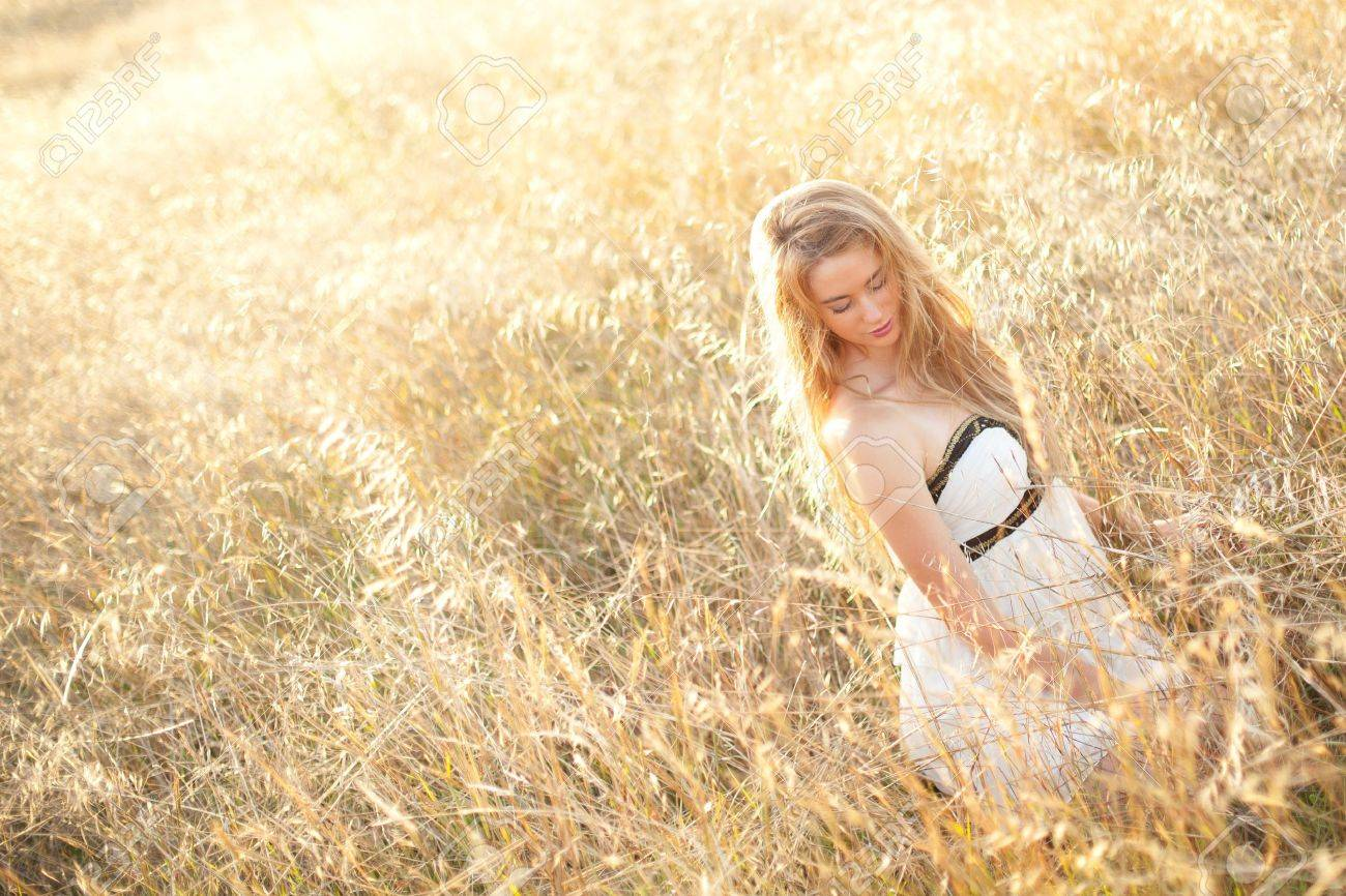 woman sitting in a field - copy space provided Stock Photo - 12600039