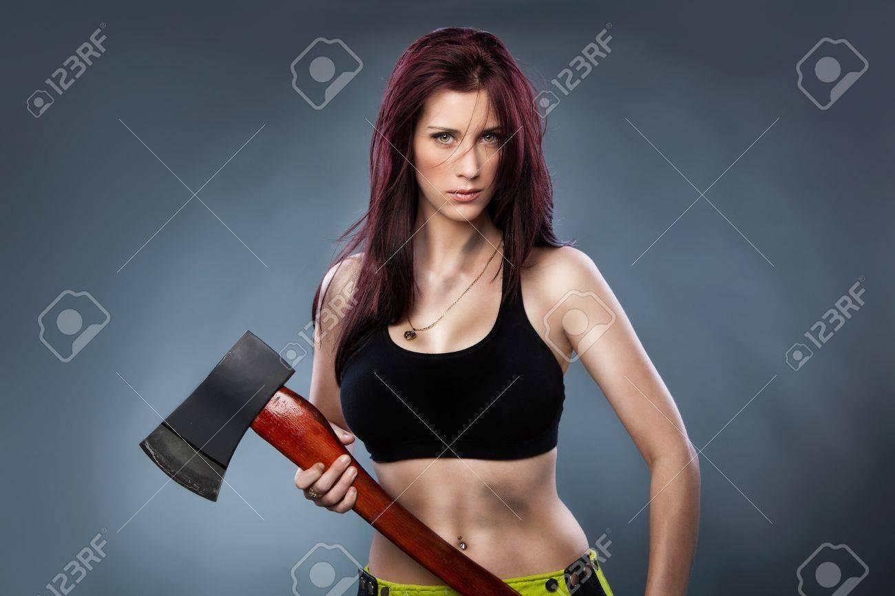 Sexy woman holding an Axe, - 15269329