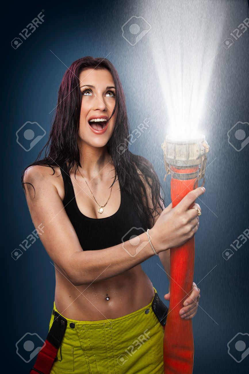 Stock Photo - Young woman spraying water in the air with a fire hose  sc 1 st  123RF.com & Young Woman Spraying Water In The Air With A Fire Hose Stock Photo ...