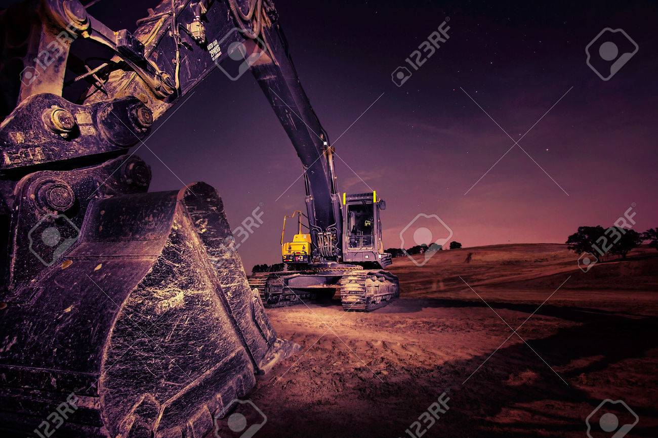 A large excavator at night Stock Photo - 27553845
