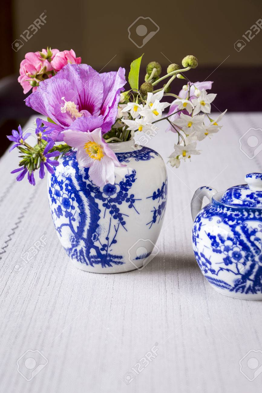 Fresh summer flowers in an oriental style blue and white china fresh summer flowers in an oriental style blue and white china ginger jar on a table dhlflorist Image collections