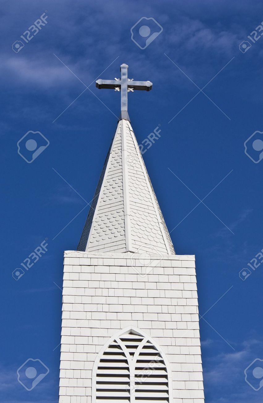 Looking up at a church steeple and cross Stock Photo - 8033605
