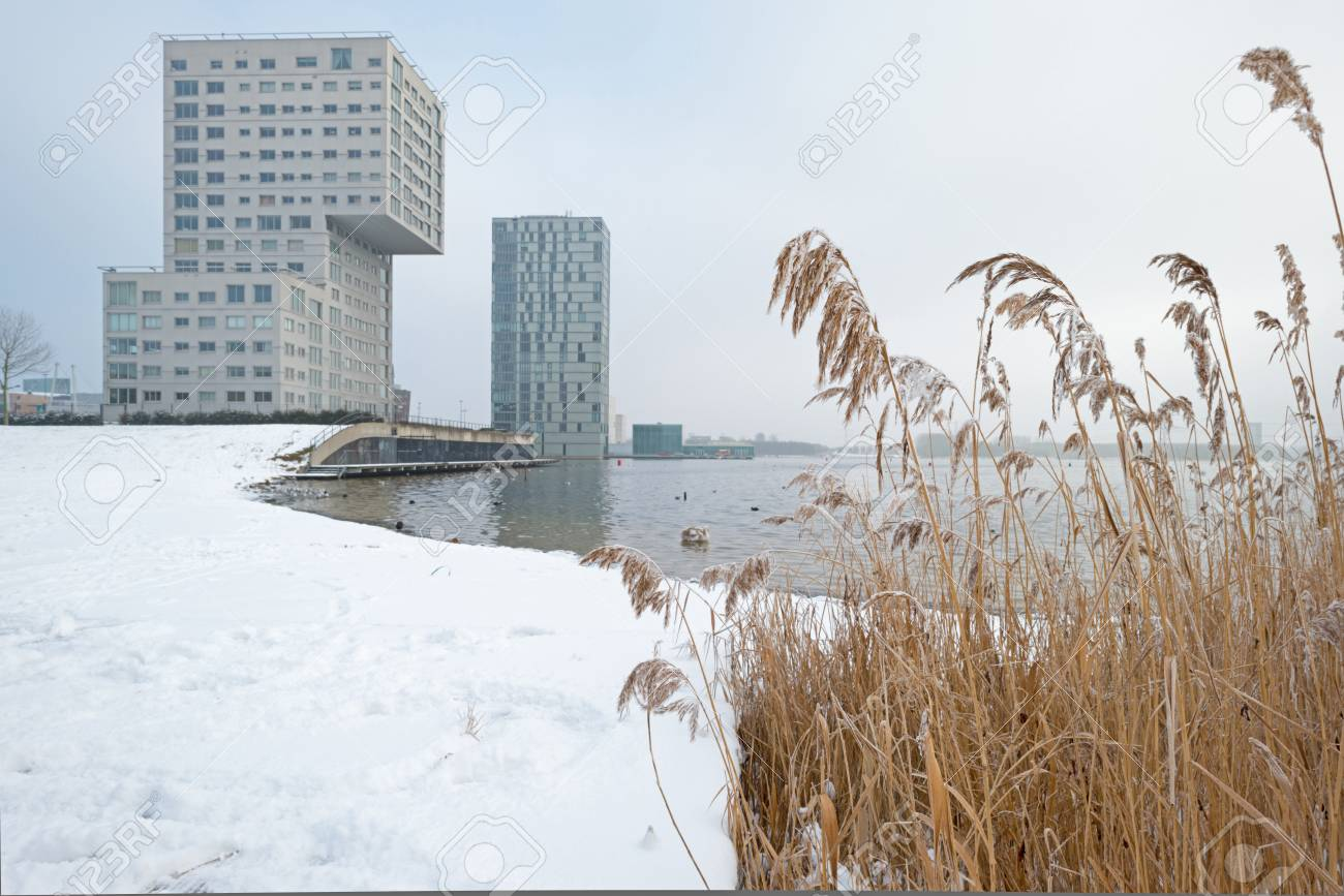 Highrise along a snowy lake in winter Stock Photo - 17376514