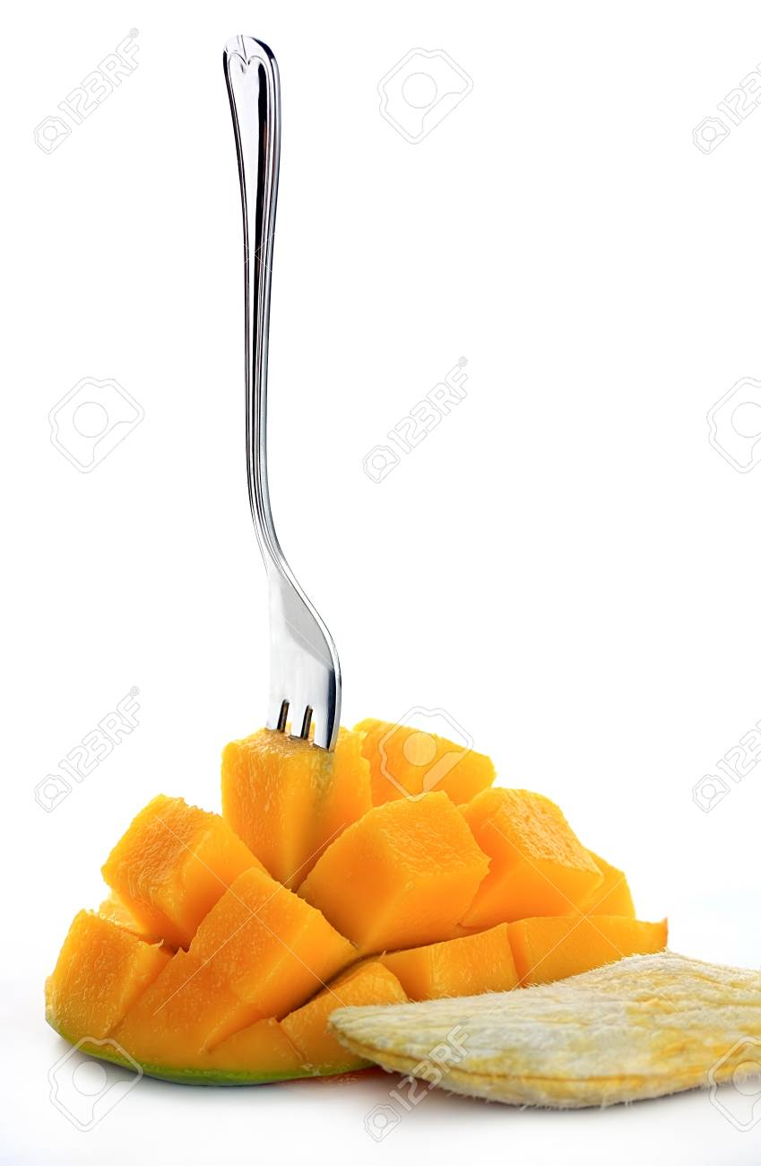 Fresh mango with fork isolated on a white background Stock Photo - 13810236
