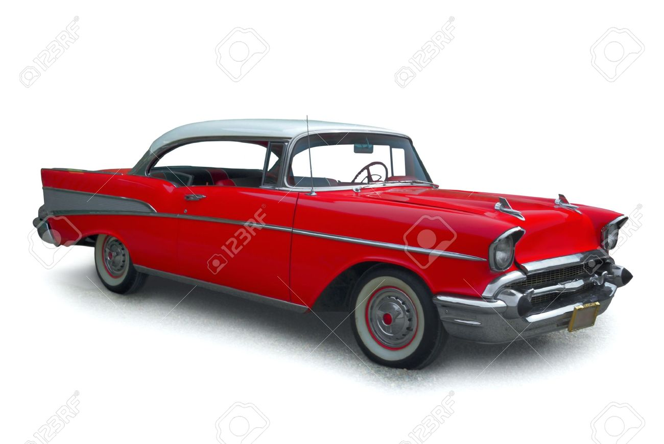 Classic Red Car With Polished Chrome Trim On A White Background