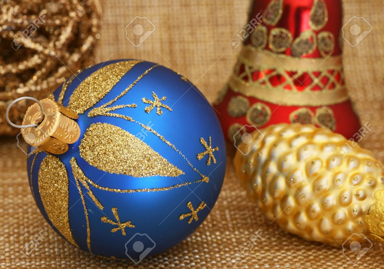 Red and gold christmas decorations - Blue Christmas Bulb With Red And Gold Christmas Decorations Stock Photo 23266715