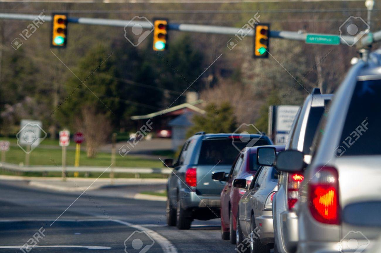 Line Of Cars Sitting At A Green Light Stock Photo, Picture And ...