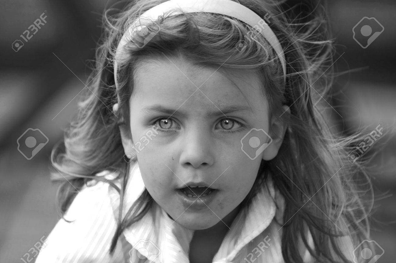 Black and white shot of a messy young girl with a blue filter giving the