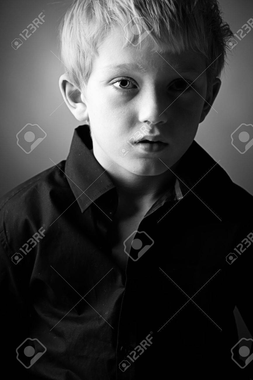 Low Key Shot of a Young Lad Looking Down Stock Photo - 5789126
