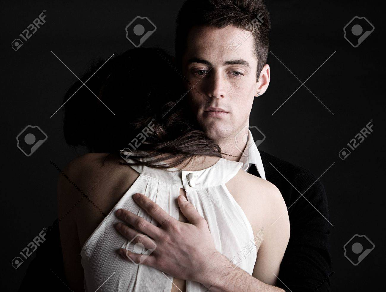 Powerful Shot of a Young Couple Embracing Stock Photo - 6593944