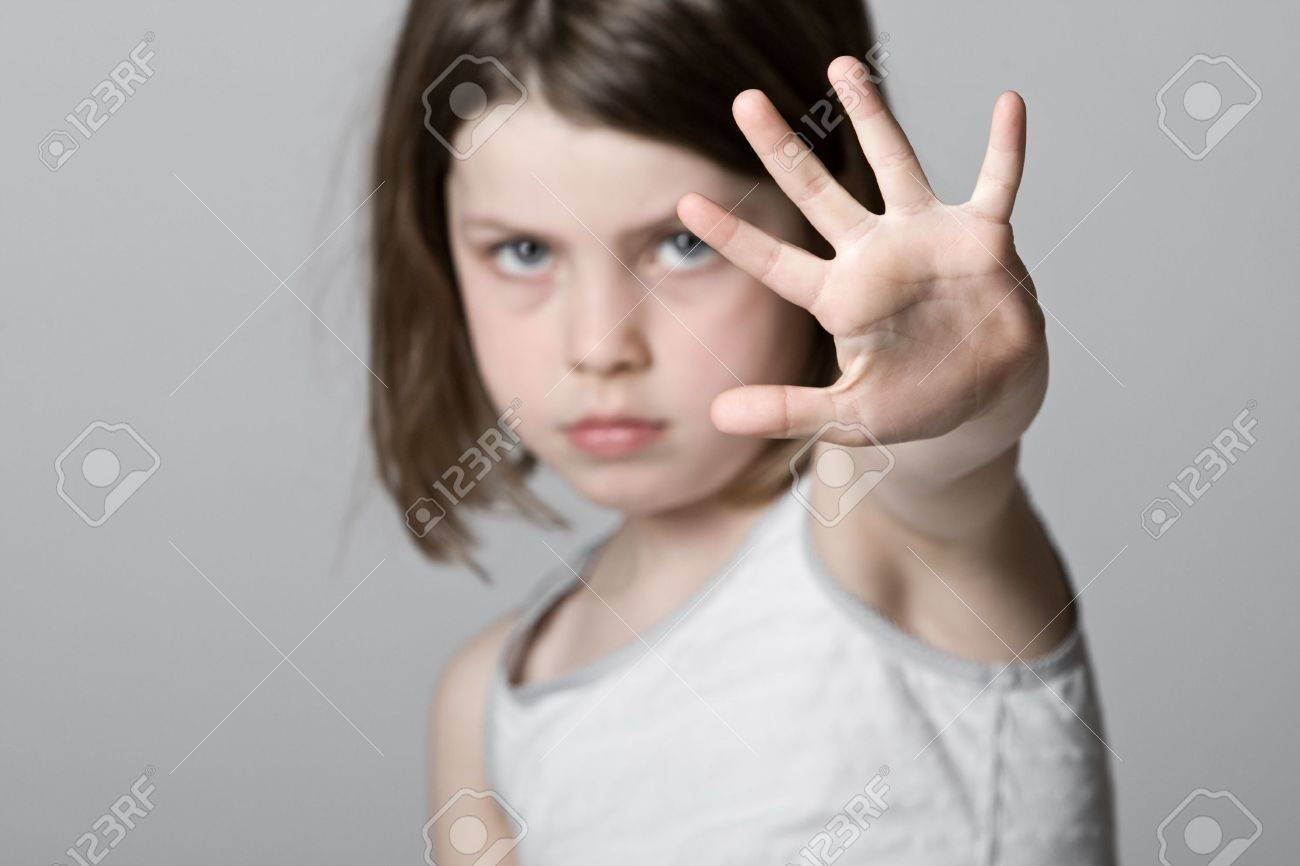 Powerful Shot of a Child with her Hand Up Stock Photo - 6878161