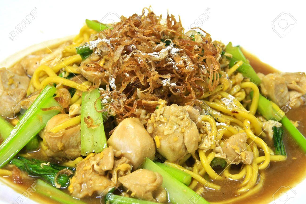 Egg Noodle Stir Fried With Chicken And Bok Choy On Top With Crispy Shallot Stock