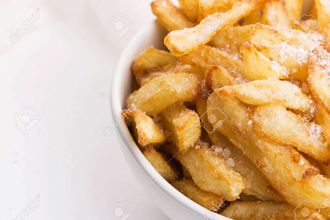 Bowl of potatoe fries on a white background - 136128246