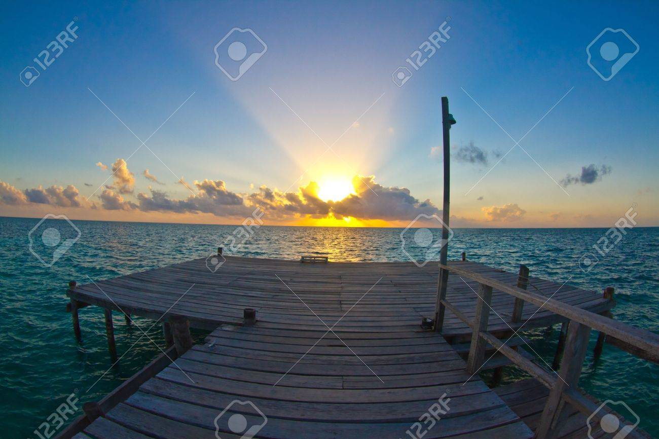 jetty at sunrise, caye caulker, belize Stock Photo - 8889786
