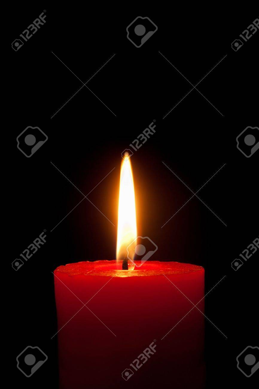 A single burning red candle  isolated in front of black background Stock Photo - 8005913