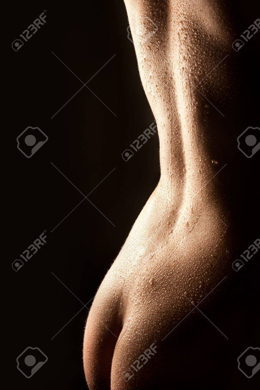 Beautiful nude wet female body in backlighting Stock Photo - 9070737