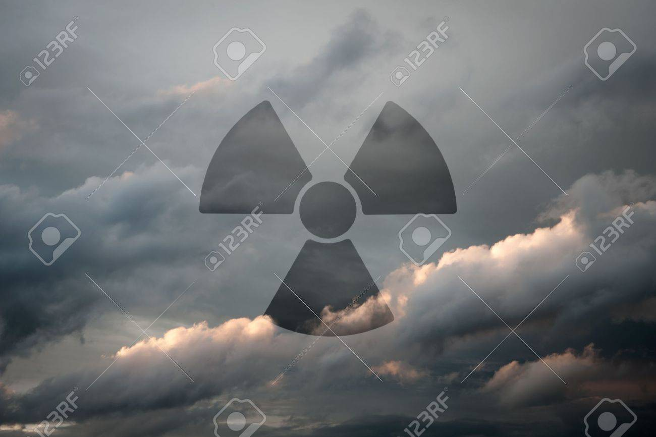 Dramatic Sky With Symbol Of Radioactivity As A Background Motive