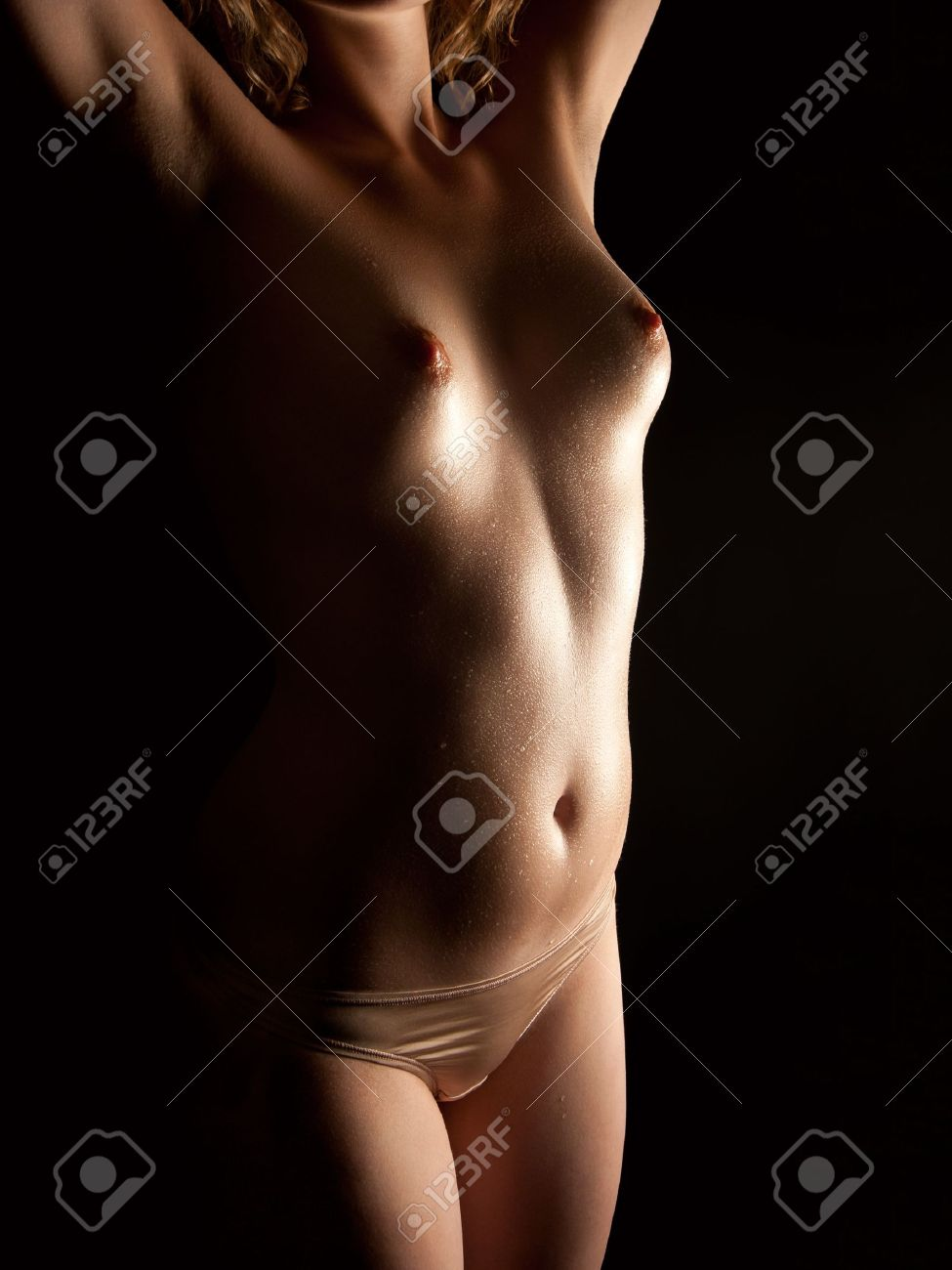 Nude of a beautiful young woman with wet body in front of black background Stock Photo - 10799033