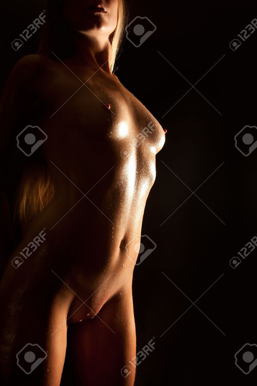 Beautiful nude blond woman with wet body in front of black background Stock Photo - 11234487