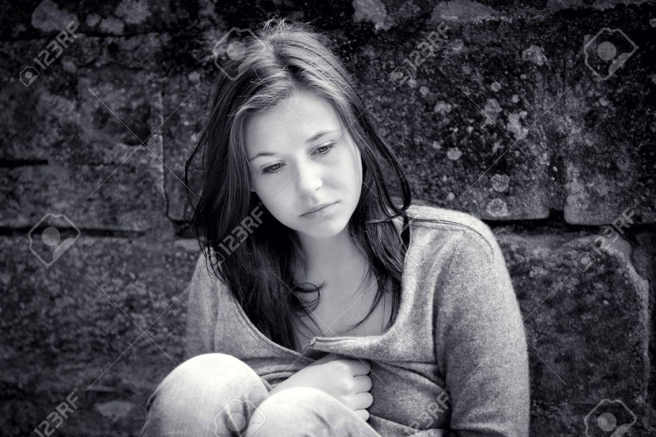 Outdoor portrait of a sad teenage girl looking thoughtful about troubles, monochrome photo Stock Photo - 11679010