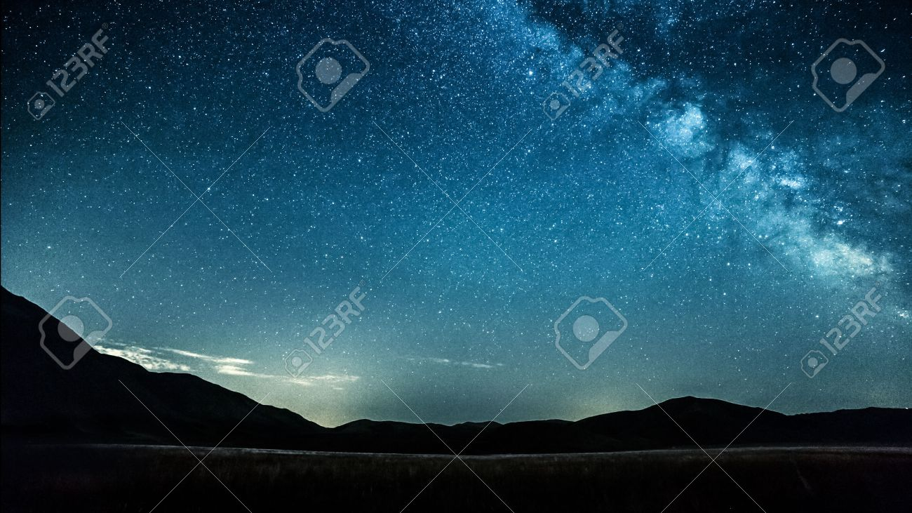 night sky with stars milky way over mountains - 52686119