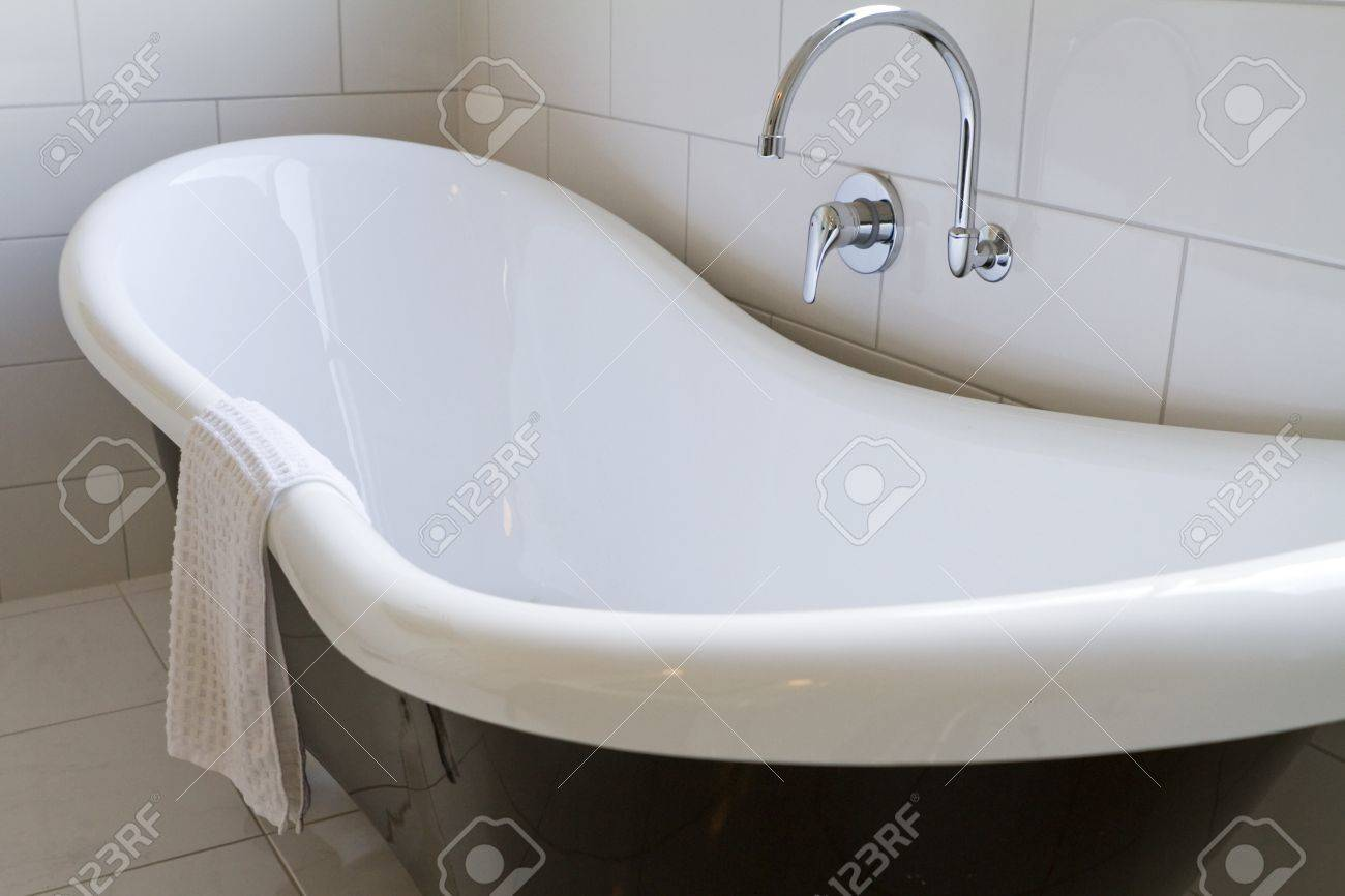 Claw Foot Bath In A White Tiled Bathroom Stock Photo, Picture And ...