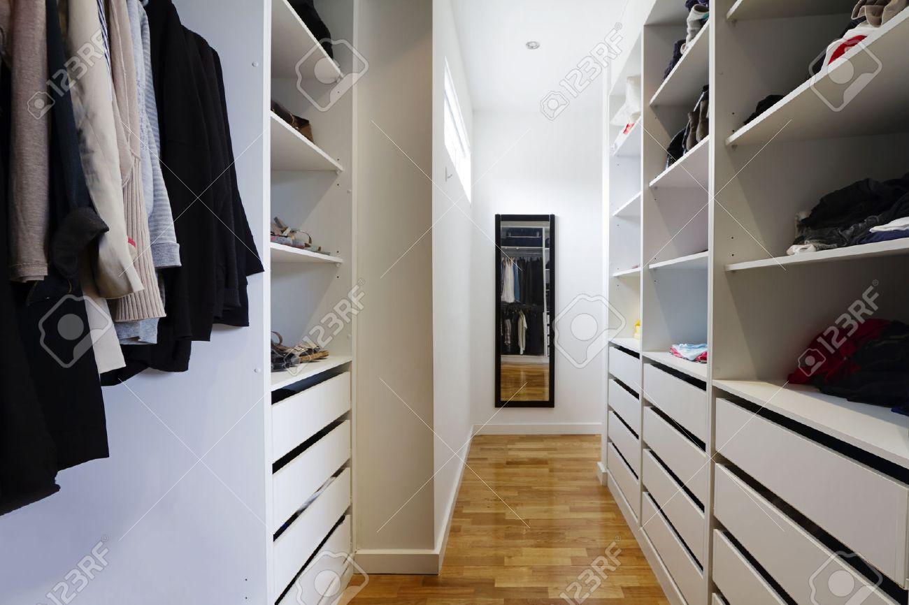Contemporary spacious walk in wardrobe in a modern home stock