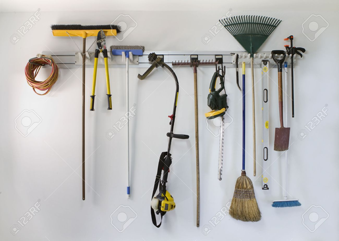 Neat Garage Tools Hanging On A Storage Rack Stock Photo   25115576