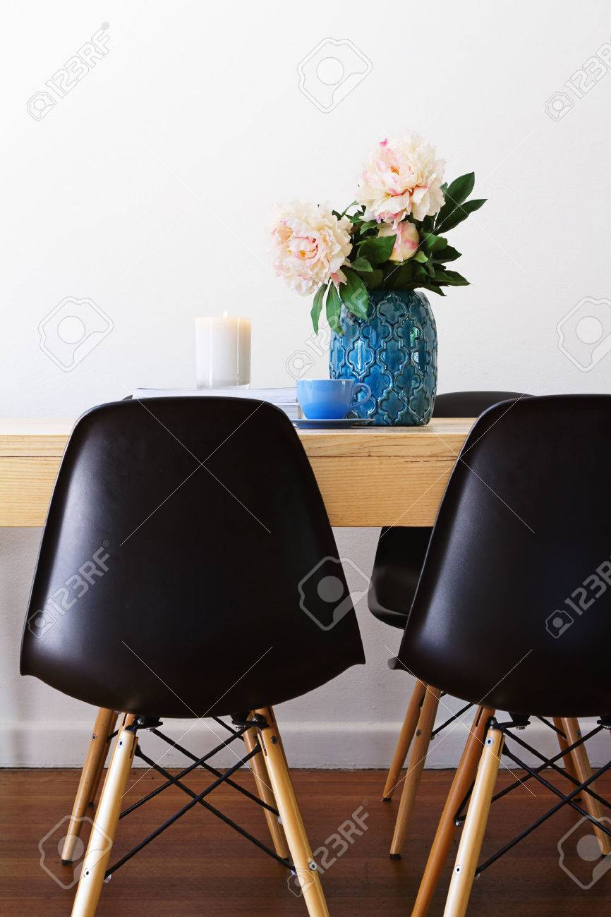 Contemporary Interior Dining Table And Retro Chairs Stock Photo ...