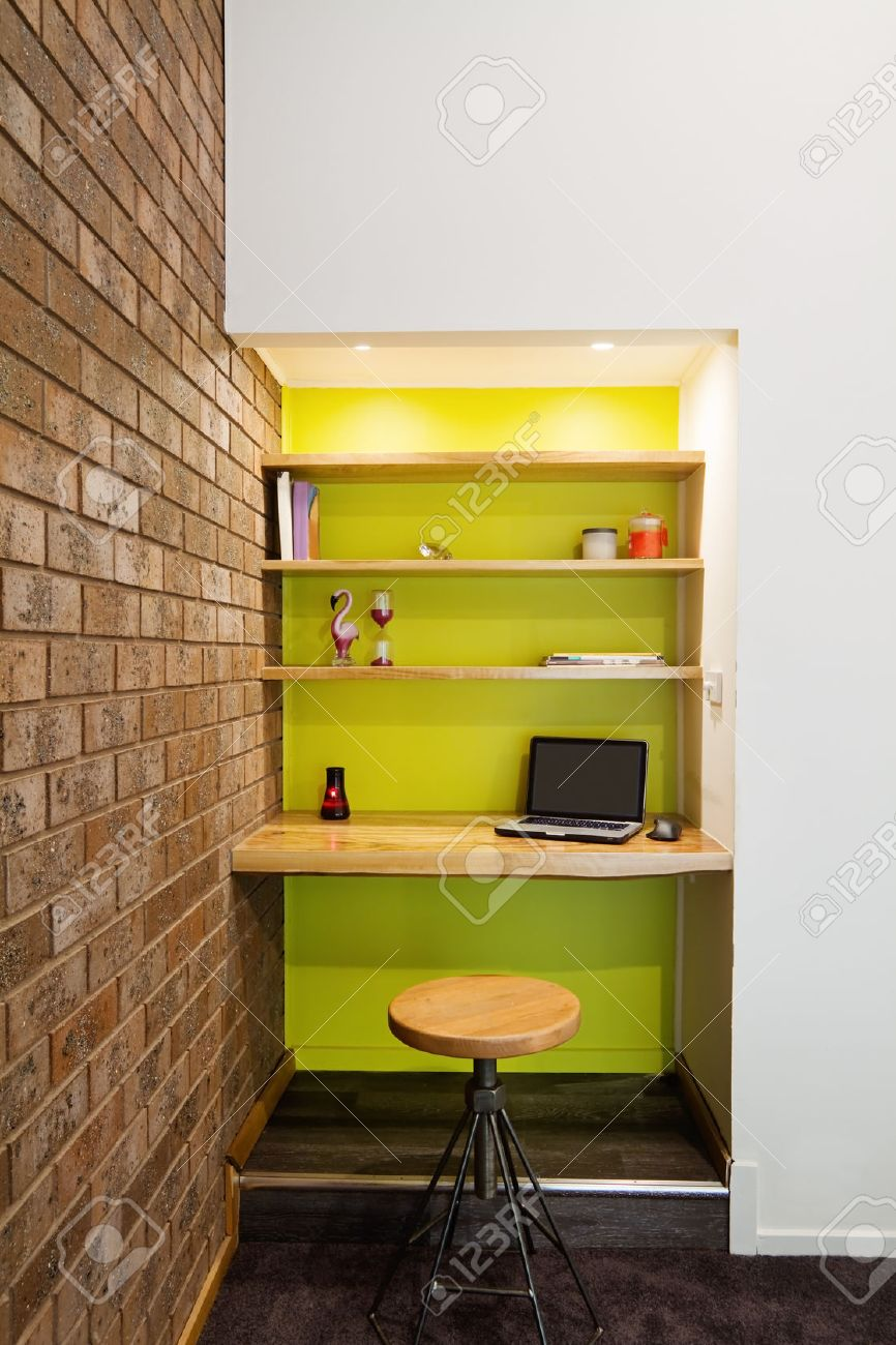 Lime Green Feature Wall Study Nook In Contemporary Living Room Stock Photo