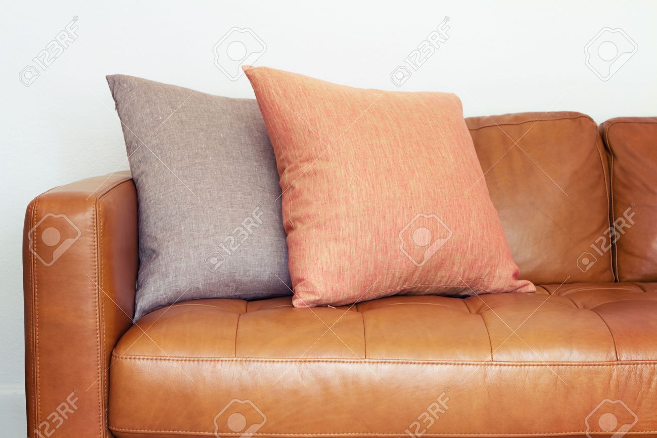 Brilliant Close Up Of Tan Leather Sofa With Two Linen Cushions Lamtechconsult Wood Chair Design Ideas Lamtechconsultcom