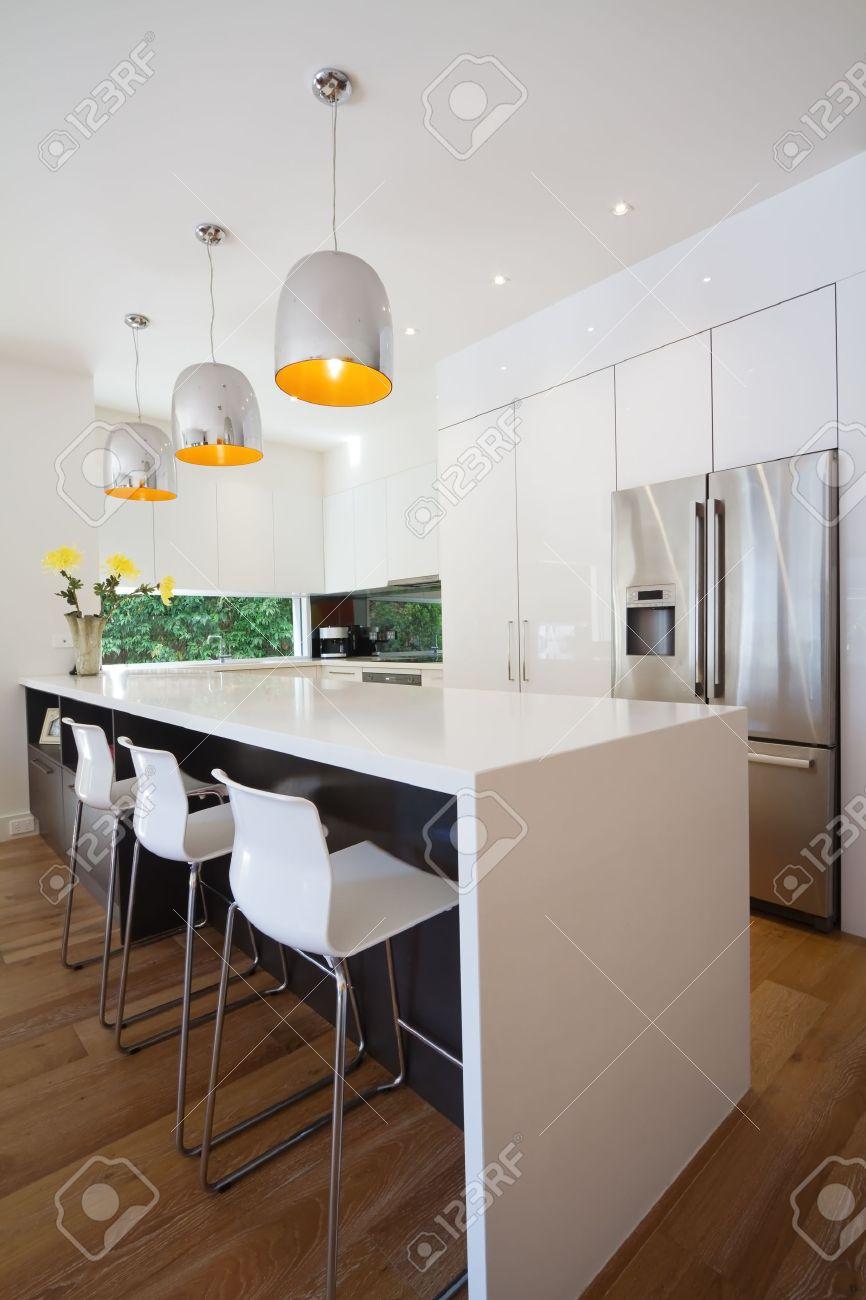 modern australian kitchen renovation with waterfall stone island