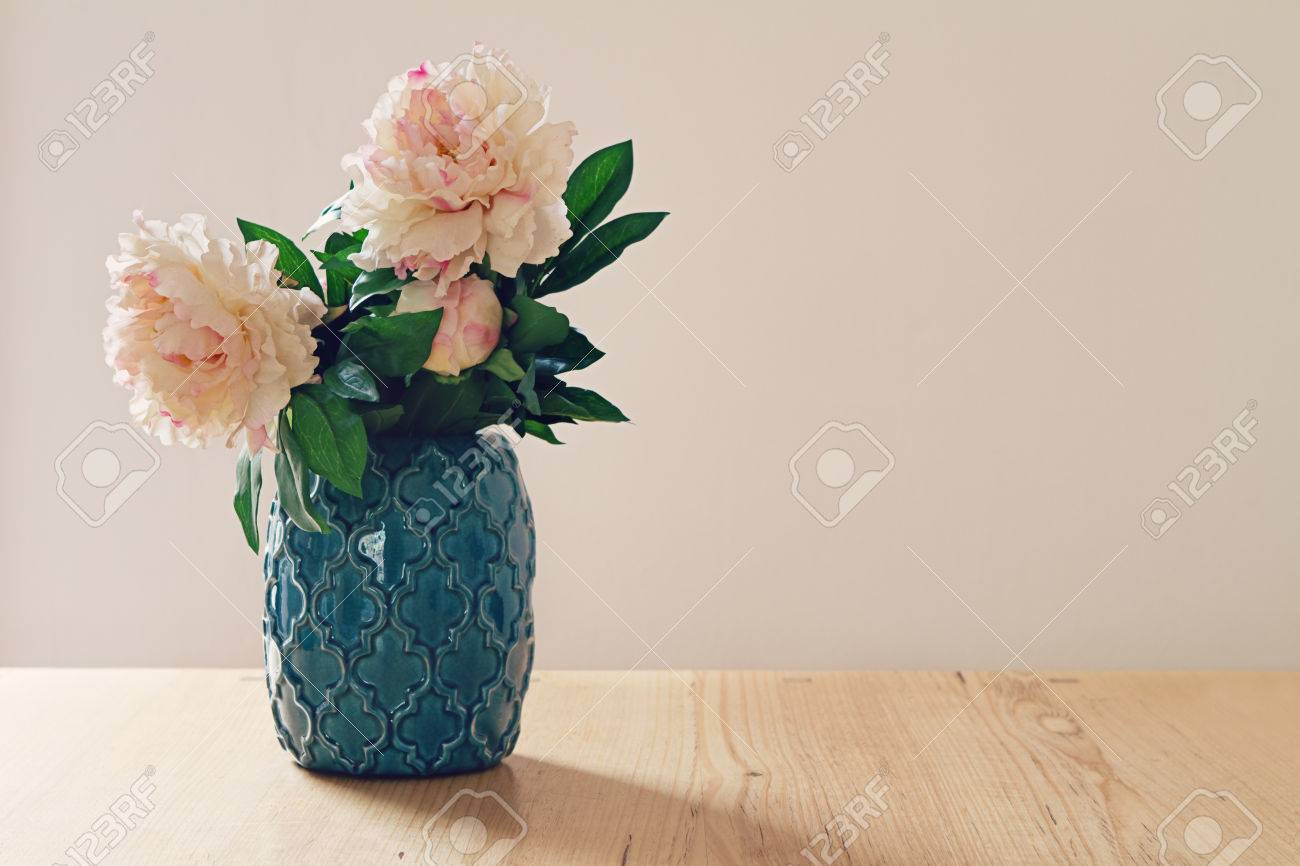 Blue Moroccan Style Vase Of Large White And Pink Flowers In Pastel