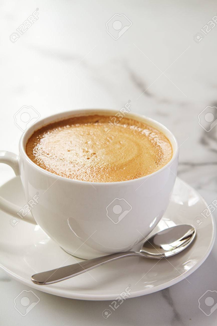 Cappucino Or Latte Milk Coffee In White Cup And Saucer On A Marble Stock Photo Picture And Royalty Free Image Image 37683467