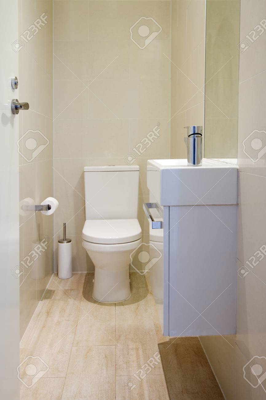 Contemporary Fully Tiled Powder Room Toilet In A New Renovated ...