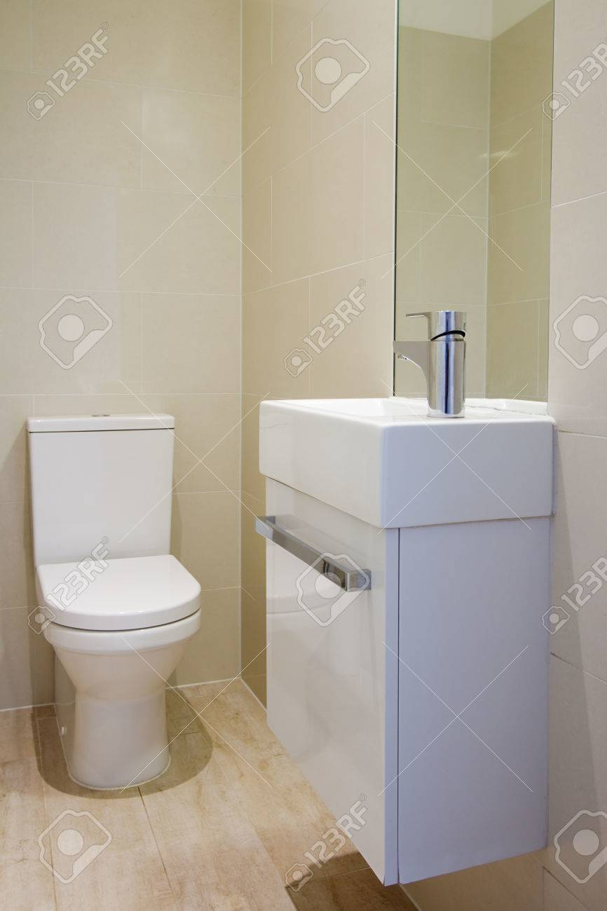 Fully Tiled Bathroom Angled View Of Newly Renovated Fully Tiled Bathroom Toilet And