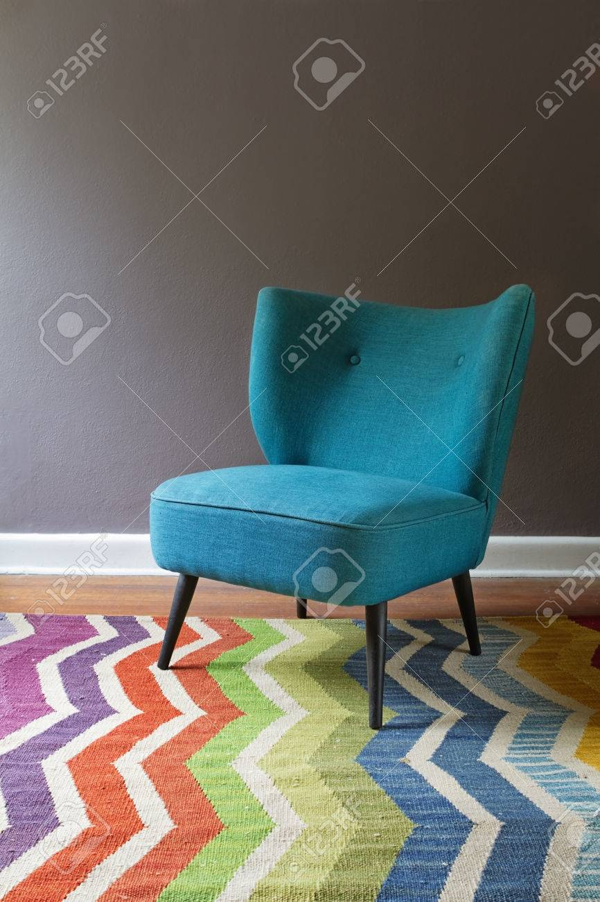 Single Teal Blue Armchair And Colorful Chevron Pattern Rug Interior Grey  Wall Stock Photo   43582960