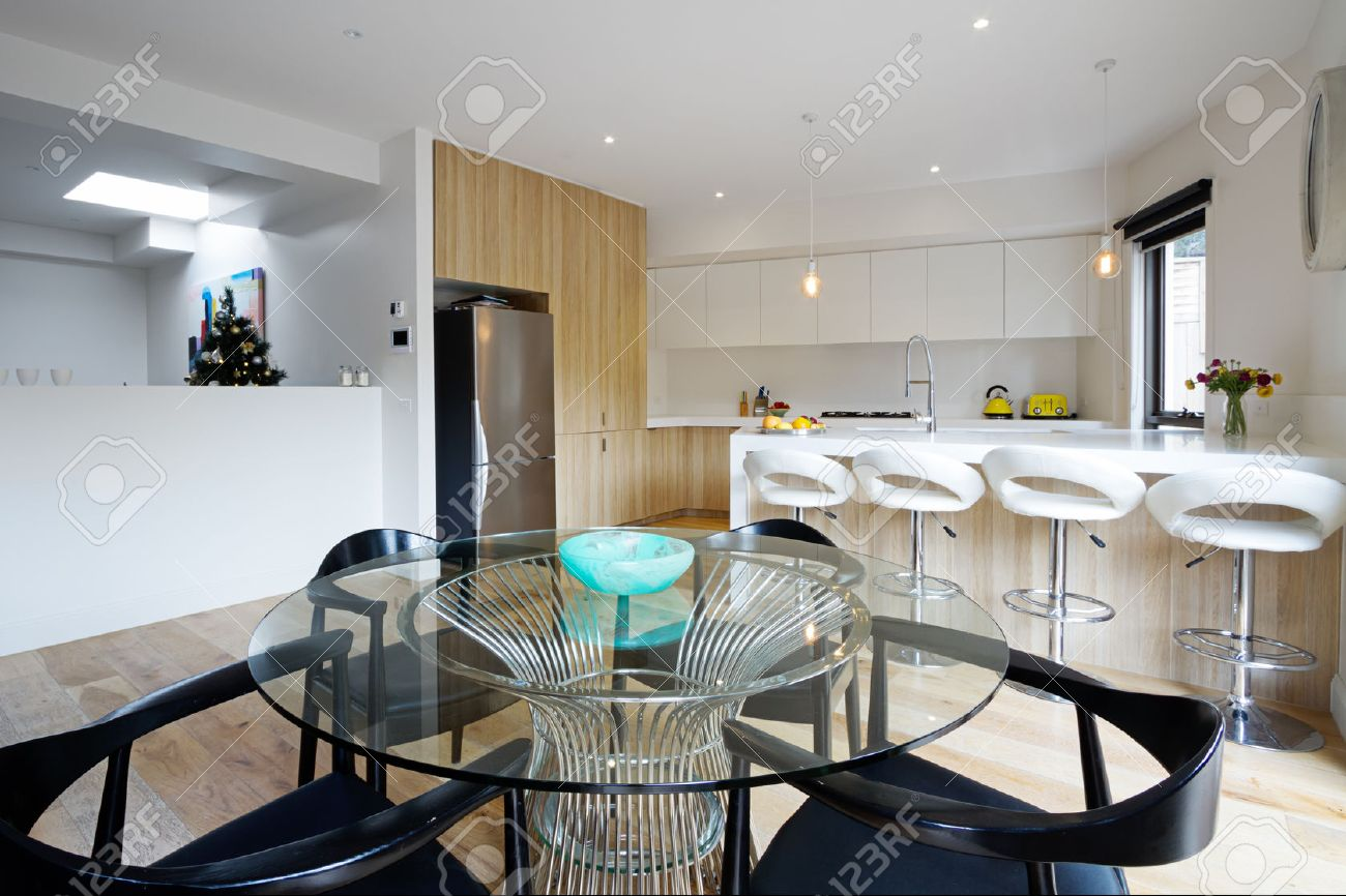 Kitchen With Island Bench And Open Plan Dining Area In Modern Australian Home Stock Photo