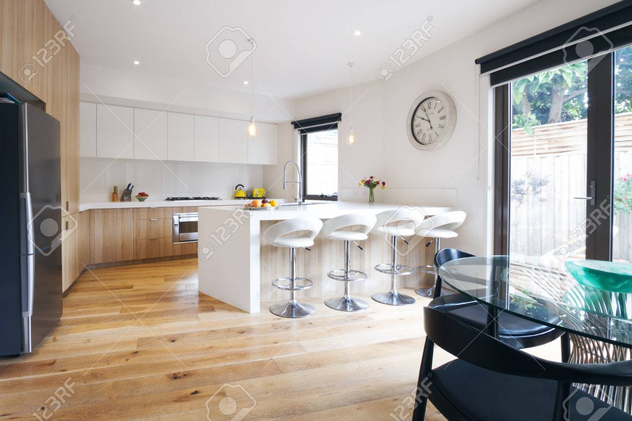 Modern Open Plan Kitchen With Island Bench And Bar Stools Stock ...