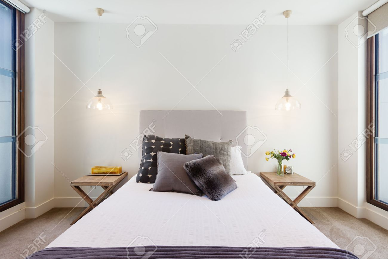 beautiful hamptons style bedroom decor in luxury home interior with pendant lighting stock photo