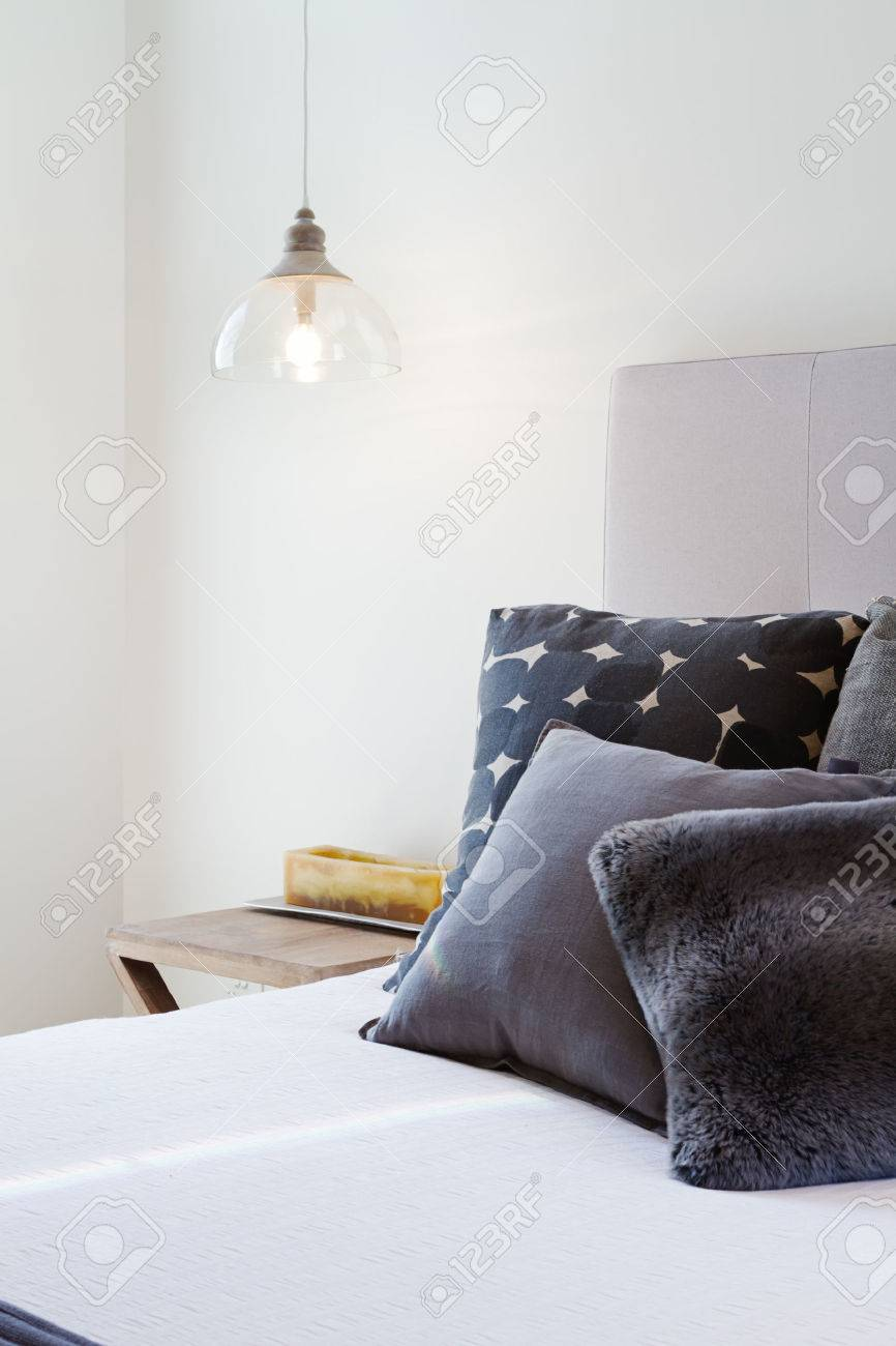 Luxury Bedroom Details Of Dark Grey Throw Pillows And Bedside