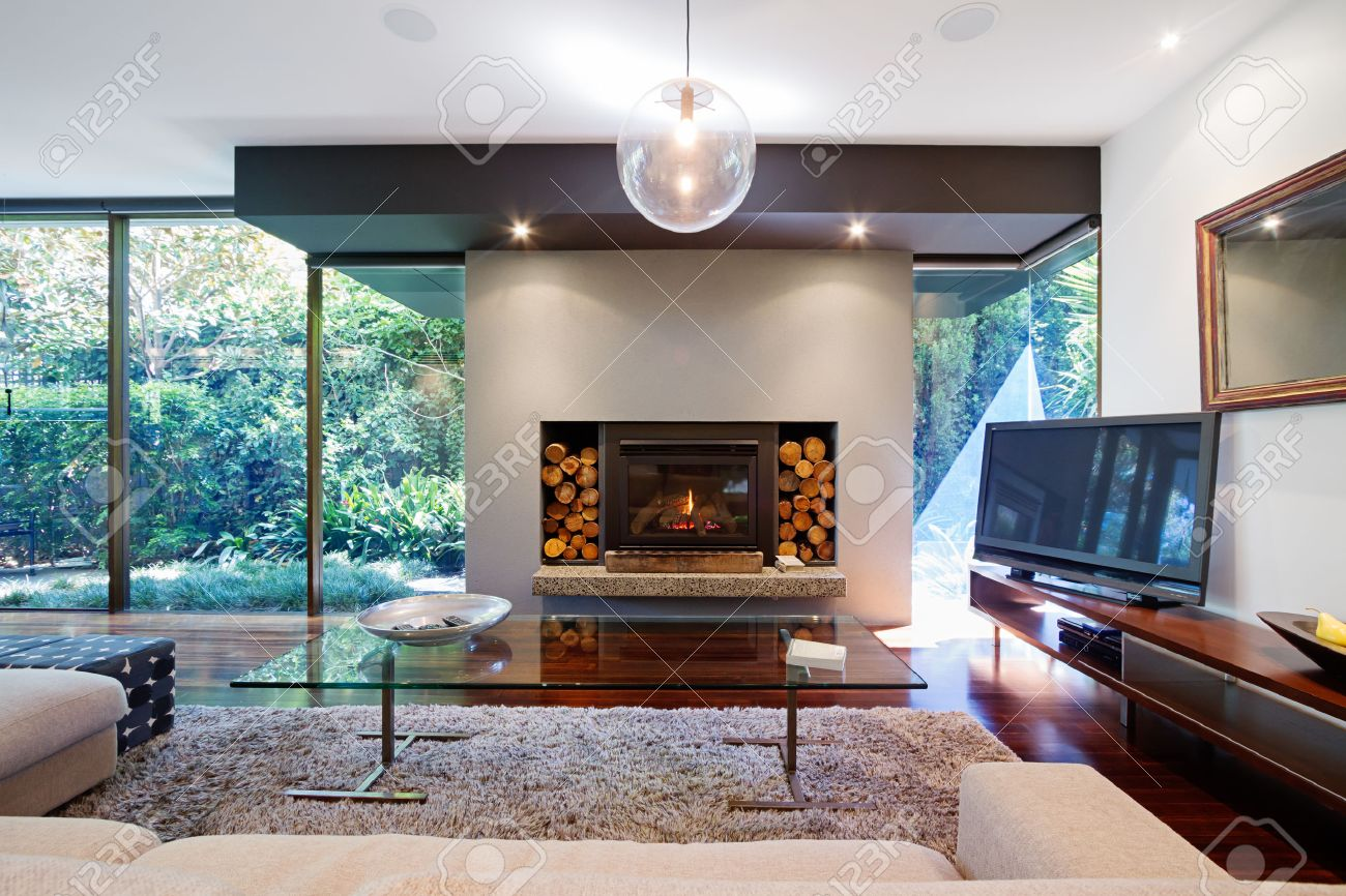 Warm Australian living room with fireplace in contemporary luxury home - 52673370