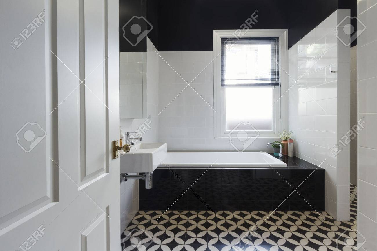 Designer Bathroom Renovation With Black And White Floor Tiles Horizontal  Stock Photo   56258370