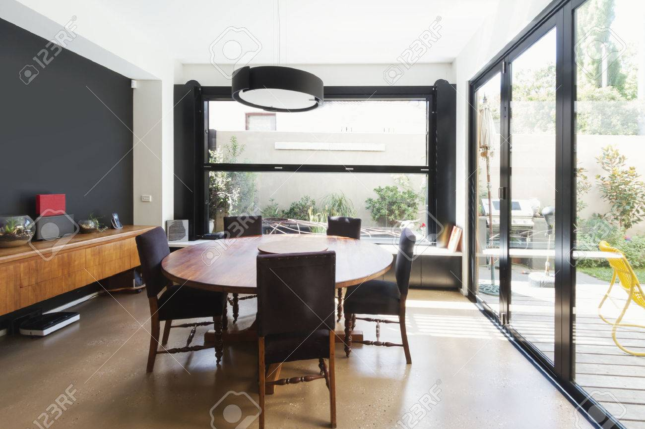 Family Dining Room Extention With Large Glass Windows And Doors In Australian Contemporary Home Stock Photo