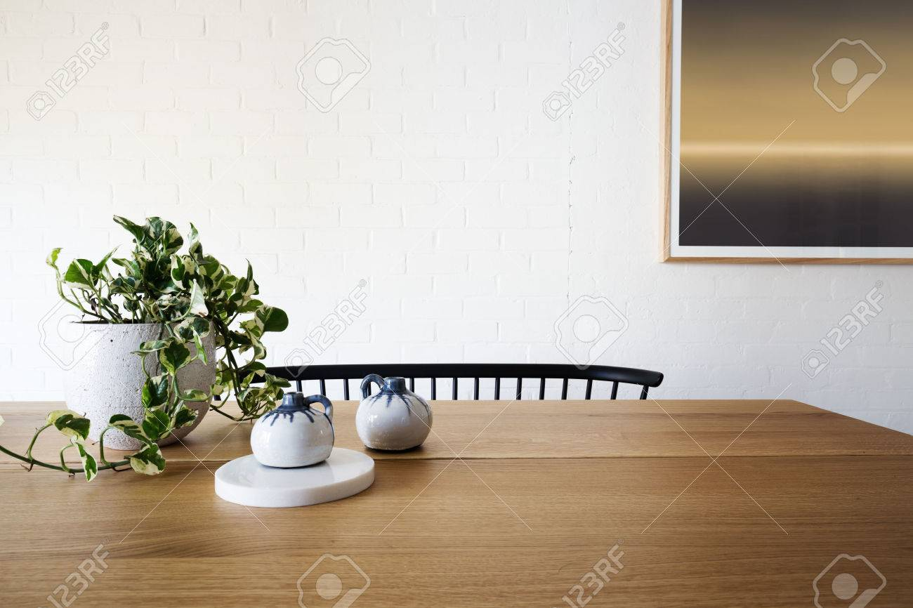 Ivy pot plant on table and white brick wall in dining room - 60332441
