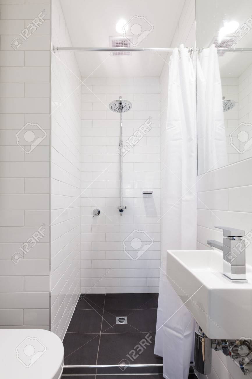 Small Renovated White Ensuite Bathroom With Rain Shower Stock Photo ...