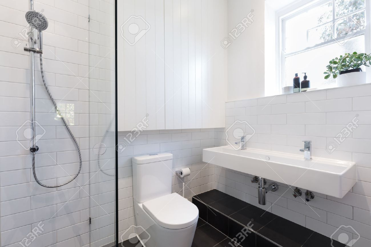Small Ensuite Bathroom With White Tiling Laid In A Brick Pattern ...