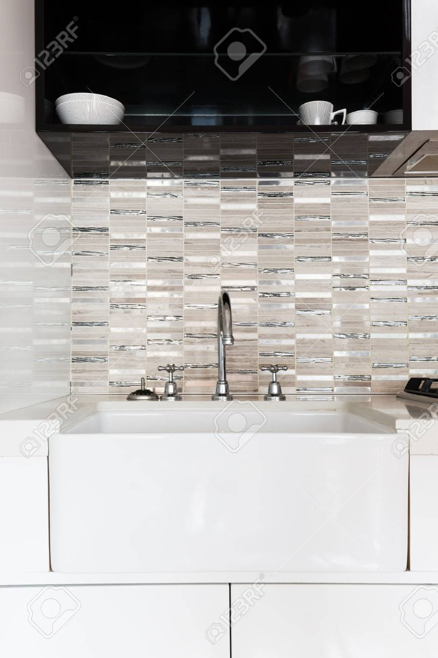 Close Up Of A Deep White Kitchen Sink And Feature Tiled Splashback Stock  Photo   63226041